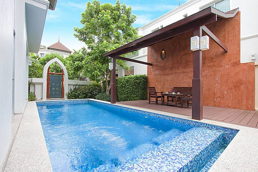 Seat and table near swimming pool Villa Modernity A in Pattaya