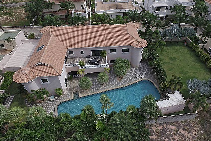 Top view swimming pool and property Camelot Villa in East Pattaya