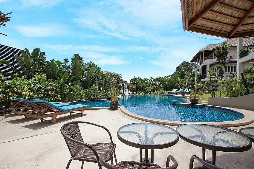 Seat and table near swimming pool Villa Janani 202 in Samui