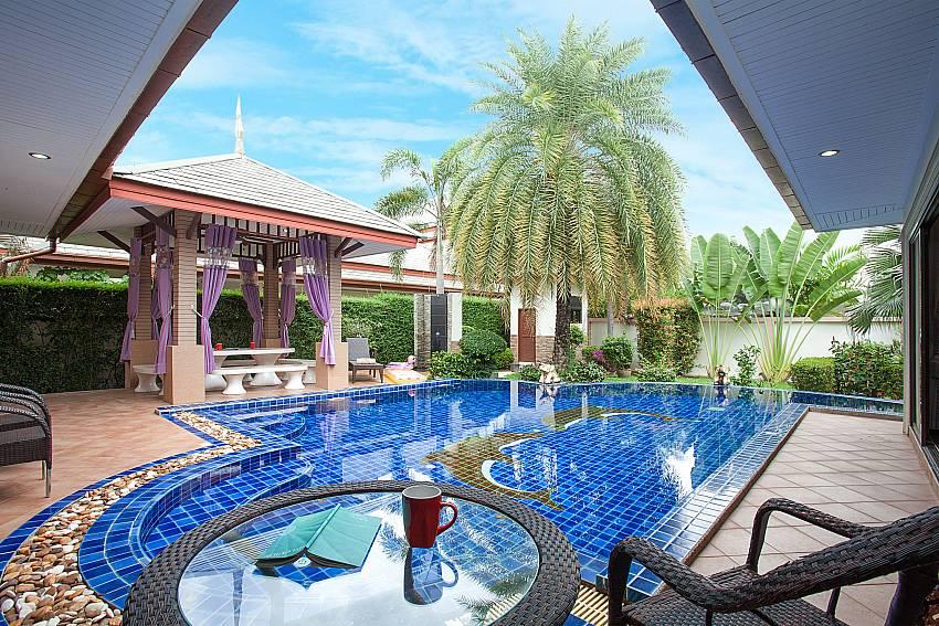 relaxing at the pool deck of-Thammachat Madonna Villa_Pattaya_Thailand