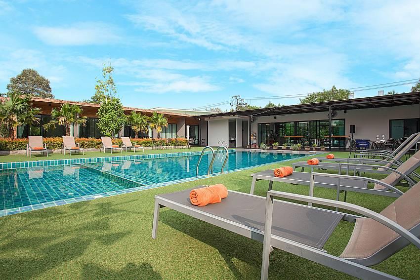 Sunlogers with pool and rooms-Stargaze Resort_Pattaya_Jomtien_Thailand