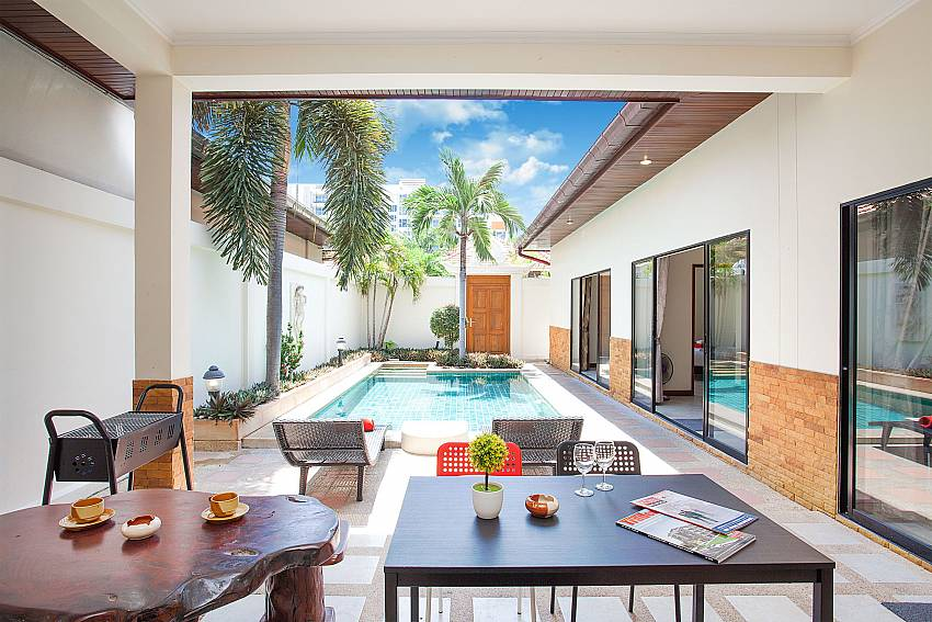 Outdoor living by the pool of 2 bedroom Villa Majestic 41 Pattaya Thailand