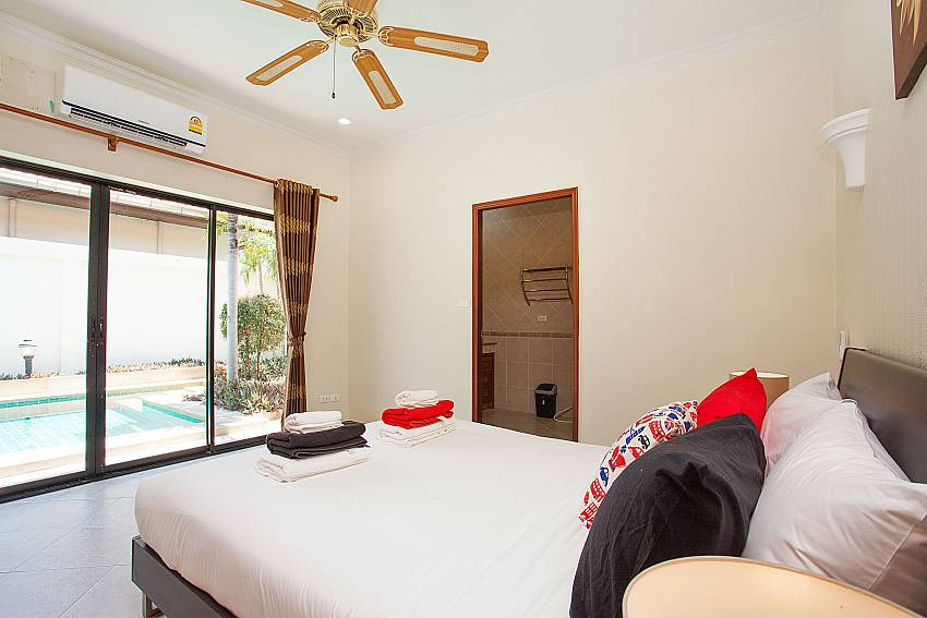 Guest bedroom with pool access in Villa Majestic 41 Pratumnak Pattaya Thailand
