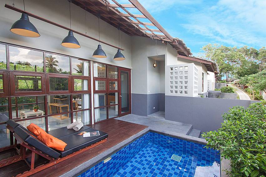 Sun bed near swimming pool with property Villa Rune 117 in Chaweng on Samui