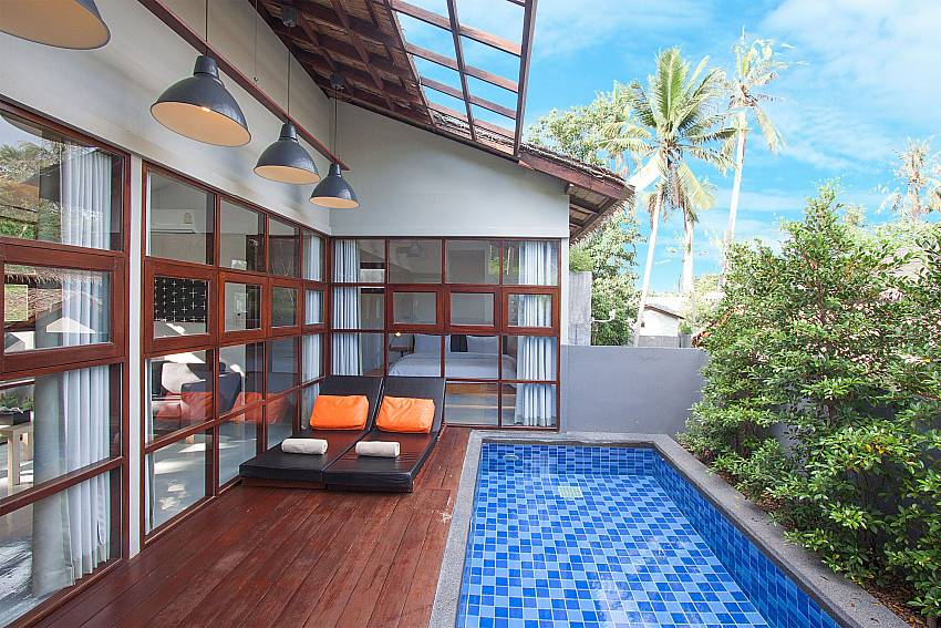 Sun bed near swimming pool with property Villa Rune 122 in Chaweng on Samui