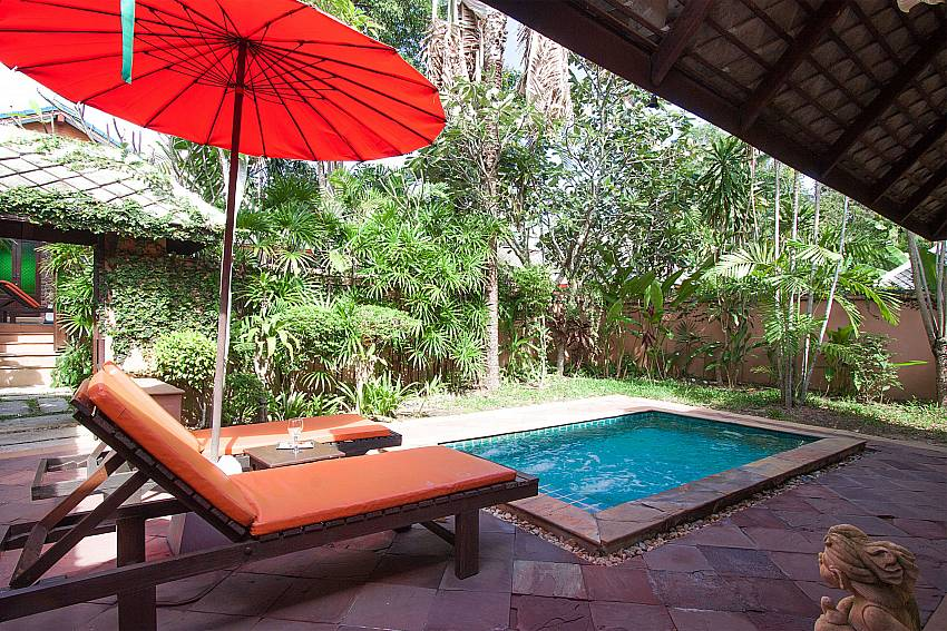 Sun bed near swimming pool with property Villa Baylea 202 in Koh Samui