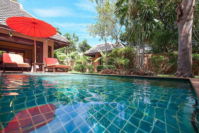 Sun bed near swimming pool with property Villa Baylea 203 in Koh Samui