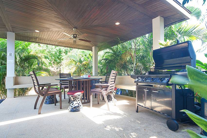 Pool side pavilion with dining table and BBQ at Villa Gaew Jiranai Phuket