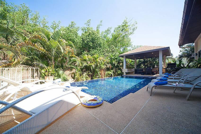 Plenty of sun beds by the private pool in Villa Gaew Jiranai Phuket