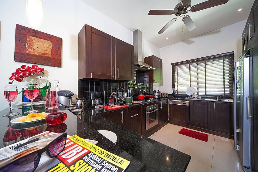 Modern kitchen at Villa Gaew Jiranai near Nai Harn Beach Phuket