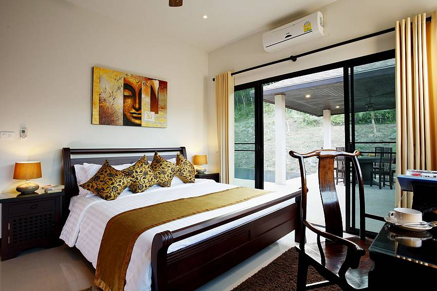 Guest bedroom with pool access at Phailin Talay South Phuket