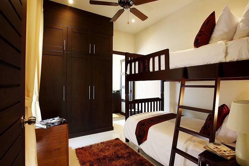 Bunk bed with plenty of storage room at Phailin Talay South Phuket