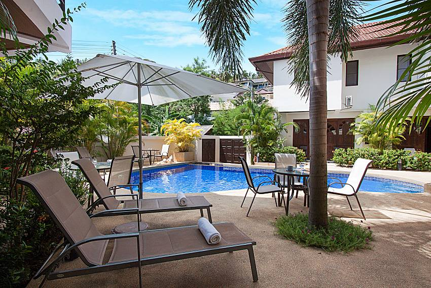 Sun beds by the poolside of Wan Hyud Apartment No.12 Koh Samui
