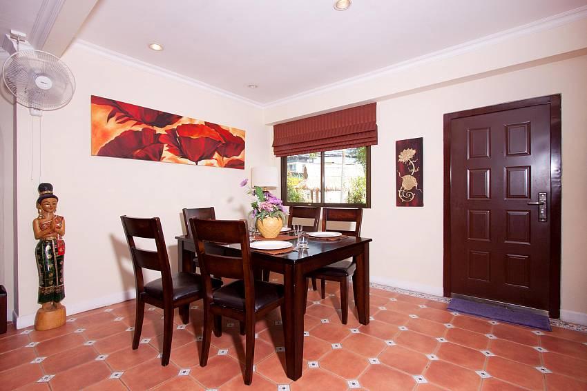 Stylish dining area at Nai Mueang Klang Villa Pattaya