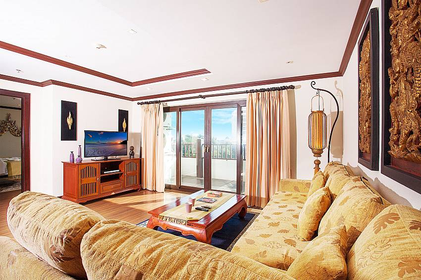 Lounge with couch and TV at Nirvana Apartment No.603 Jomtien Pattaya