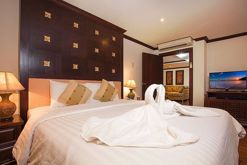 Bedroom with king size bed at 4 seat dining table at Nirvana Apartment No.603 Jomtien Pattaya Thailand