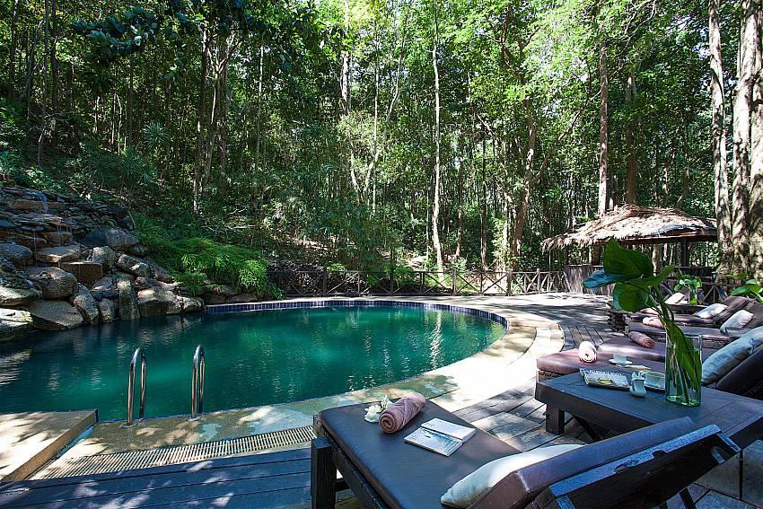 Sun bed near swimming pool Natures Oasis Resort No.9 in Bang Bao Koh Chang
