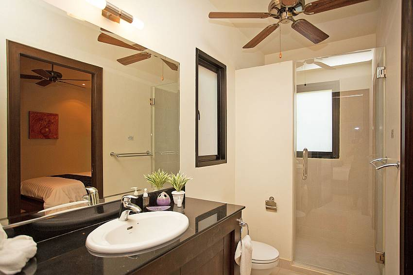 Modern bathrooms at Morakot Villa in Nai Harn Phuket