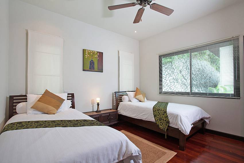 Twin Bedroom Upstairs-Morakot Villa_6 Bedroom_Private Pool Villa_Nai Harn_Phuket_Thailand