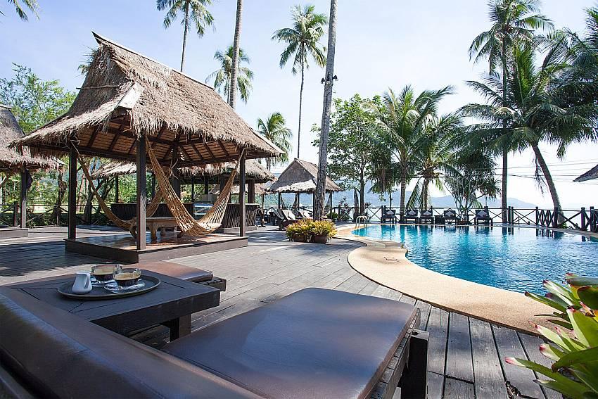 Sun bed near swimming pool Natures Oasis Resort No.7A in Bang Bao Koh Chang