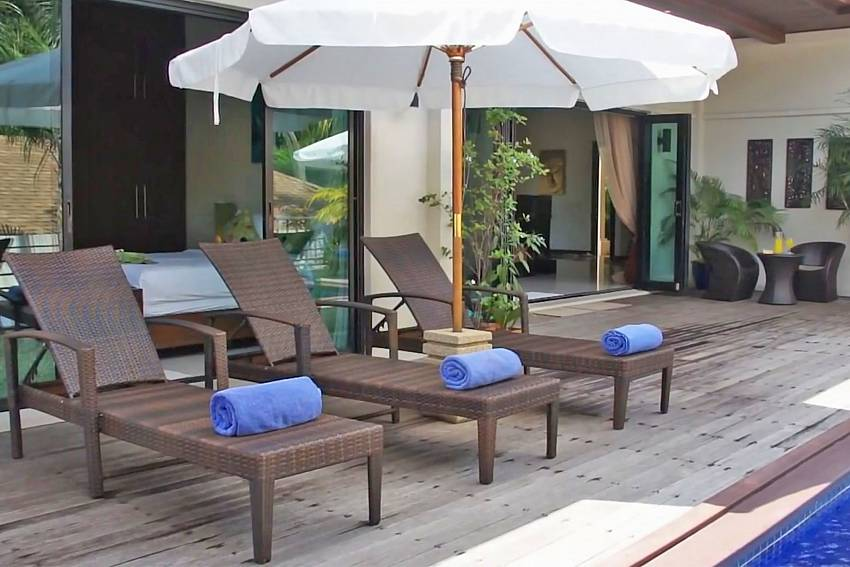 Sun beds by the private pool in Ploi Jantra Villa Nai Harn South Phuket