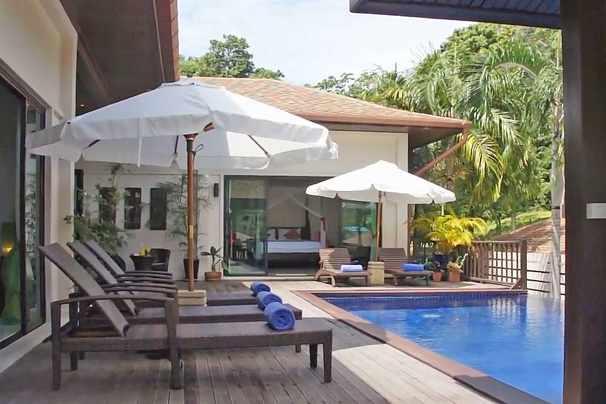Plenty of sun loungers by the private pool at Ploi Jantra Villa Phuket