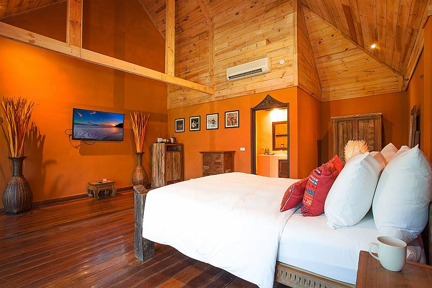 Bedroom with TV Natures Oasis Resort No.8A at Bang Bao Koh Chang