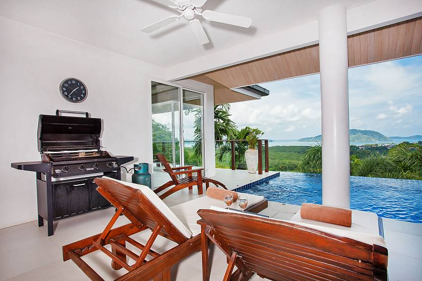 Covered relaxing area with BBQ by the pool of Villa Alangkarn Andaman Phuket