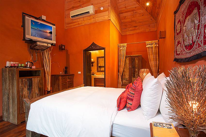 Bed room with TV Natures Oasis Resort No.11B in South Koh Chang