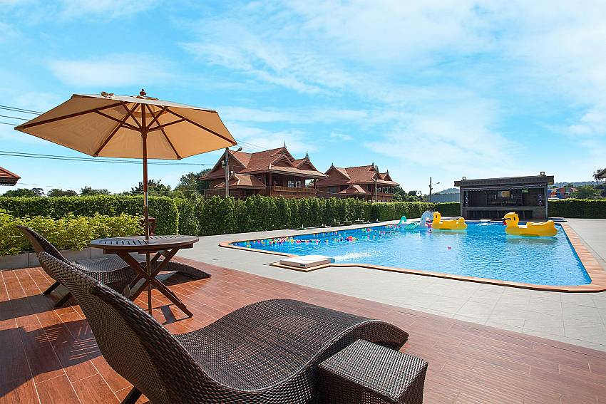 Sun bed near swimming pool Timberland Lanna Villa 302 in Bangsaray Pattaya
