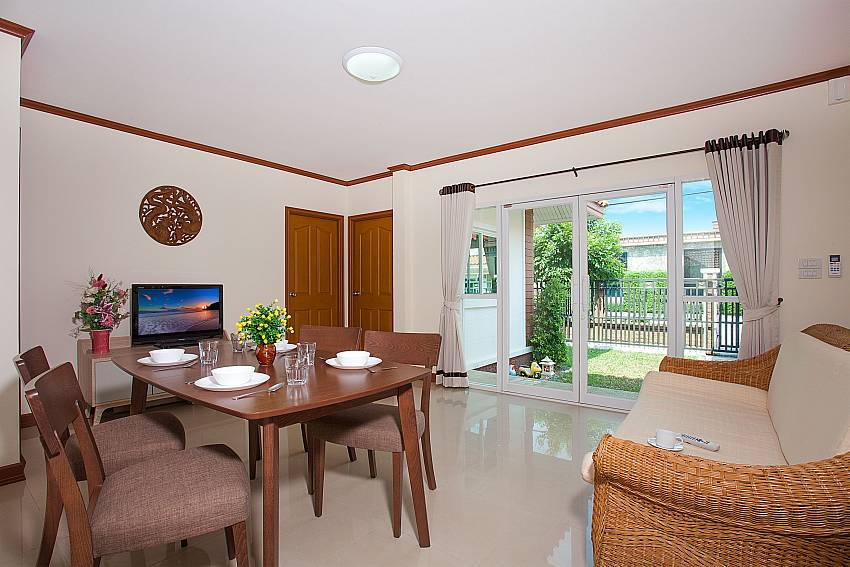 Dinning area with TV Timberland Lanna Villa 302 in Bangsaray Pattaya