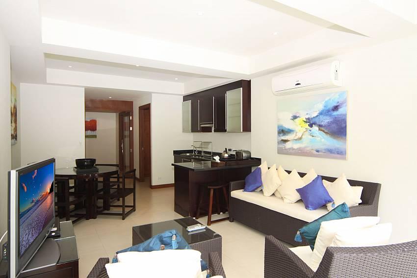 Small living room with TV at Narumon Nai Harn Phuket