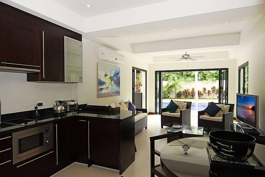 Kitchenwith TV room at villa Narumon Nai Harn Phuket