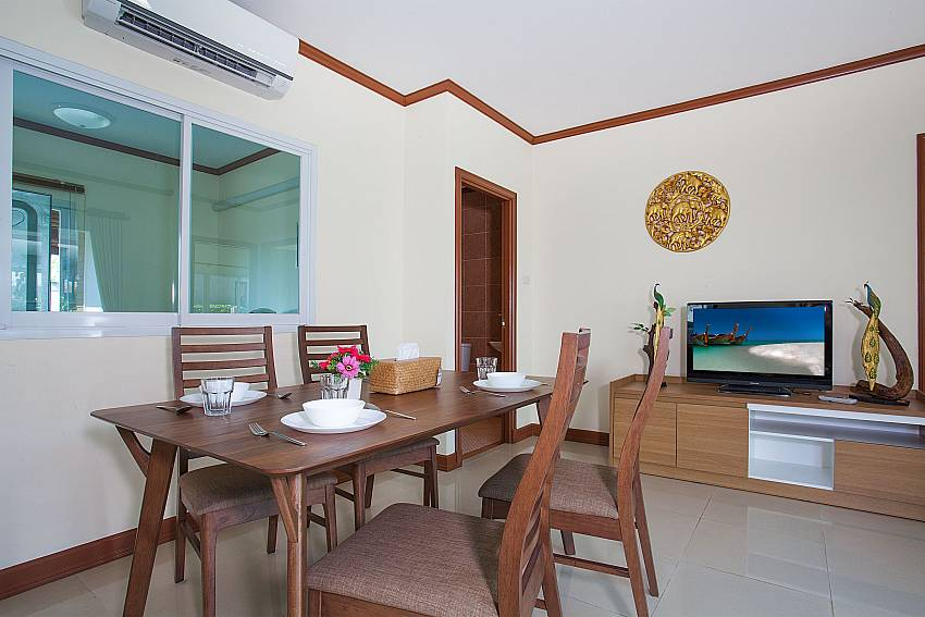 Dinning area with TV Timberland Lanna Villa 303 in Bangsaray Pattaya