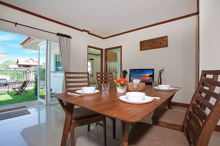 Dinning area with TV Timberland Lanna Villa 304 in Bangsaray Pattaya