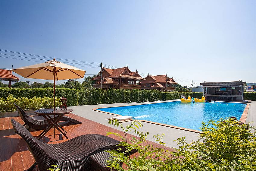 Sun bed near swimming pool Timberland Lanna Villa 306 in Bangsaray Pattaya