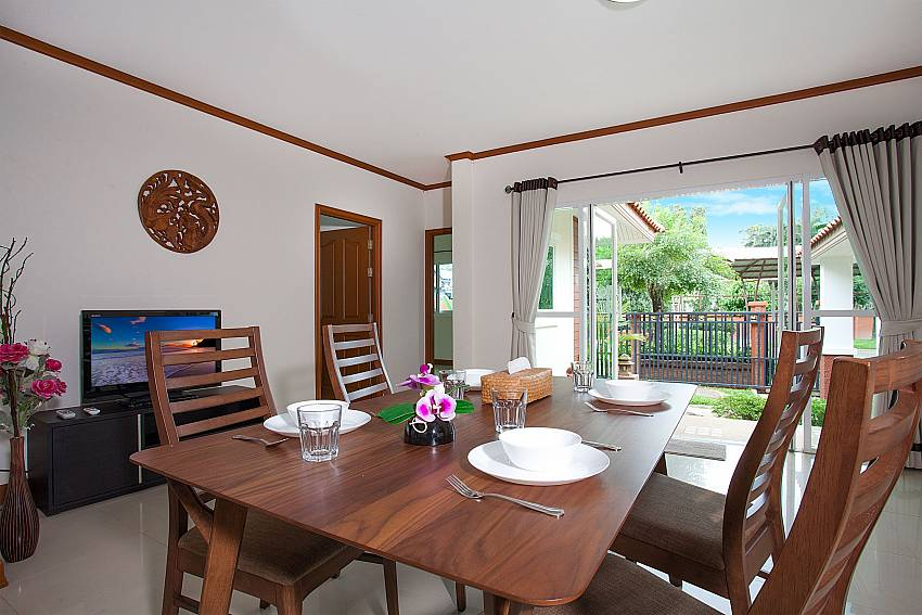 Dinning area with TV Timberland Lanna Villa 306 in Bangsaray Pattaya