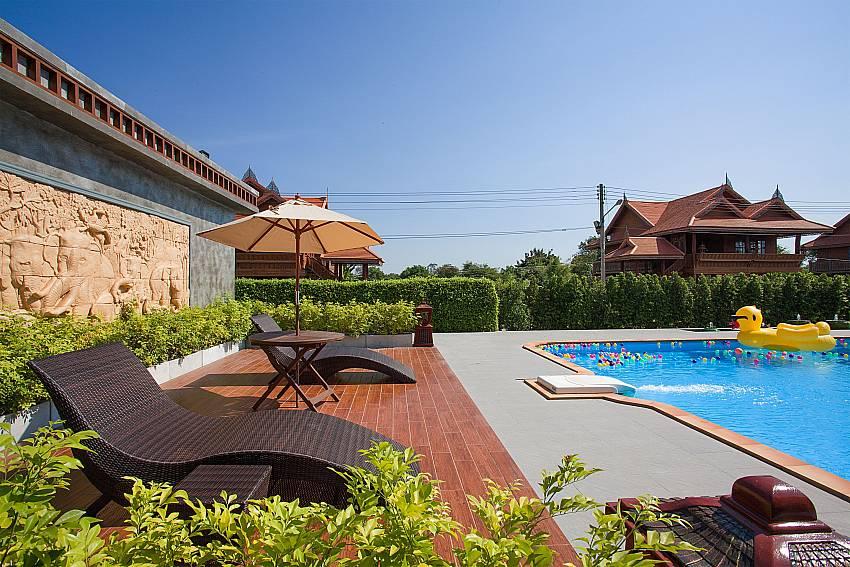 Sun bed near swimming pool Timberland Lanna Villa 403 in Pattaya
