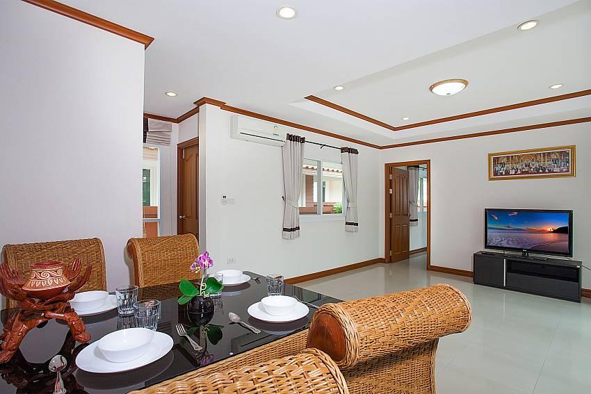 Dinning area with TV Timberland Lanna Villa 403 in Pattaya