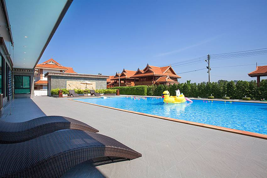 Sun bed near swimming pool Timberland Lanna Villa 201 in Bangsaray Pattaya