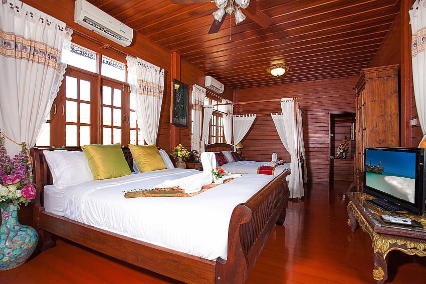 Bedroom with TV Timberland Lanna Villa 201 in Bangsaray Pattaya
