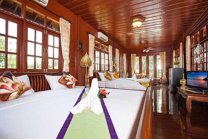 Bedroom with TV Timberland Lanna Villa 202 in Pattaya