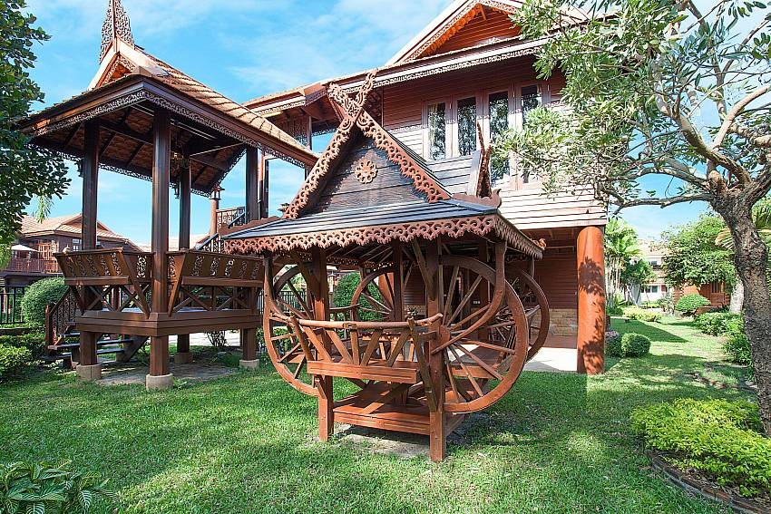Seat area in garden Timberland Lanna Villa 202 in Pattaya