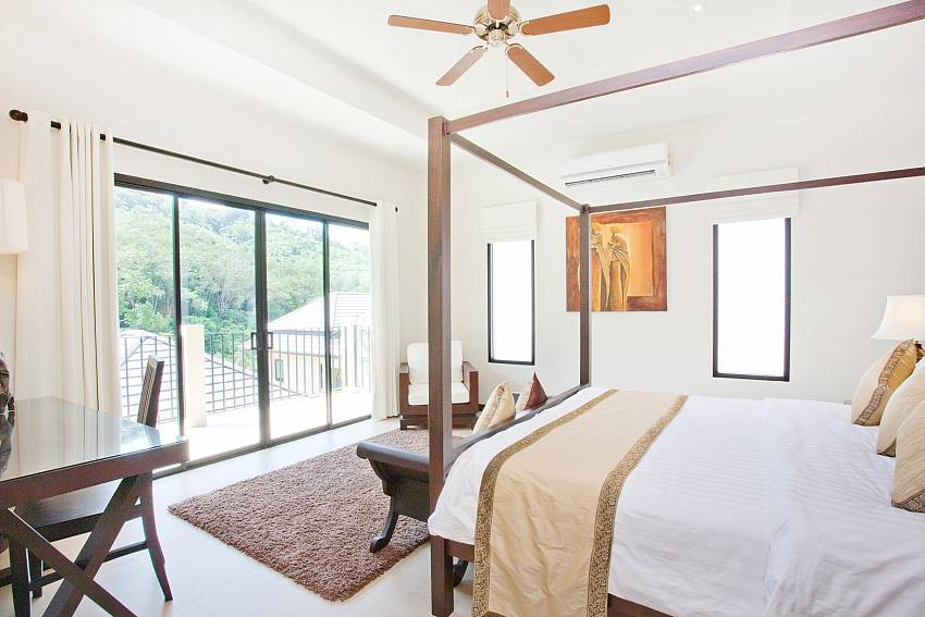 Main master bedroom with 4 poster king size bed at Waew Opal Phuket