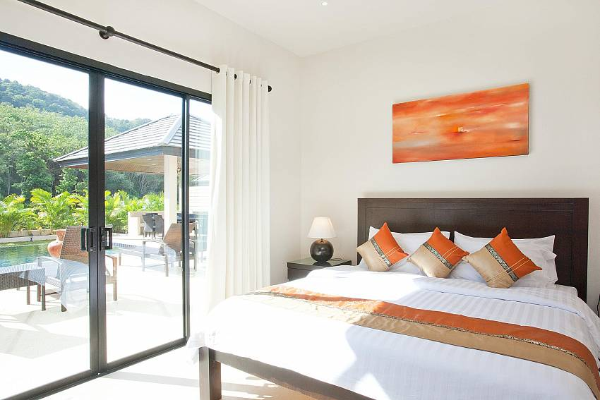 4. bedroom with king size bed and pool access at Waew Opal Phuket