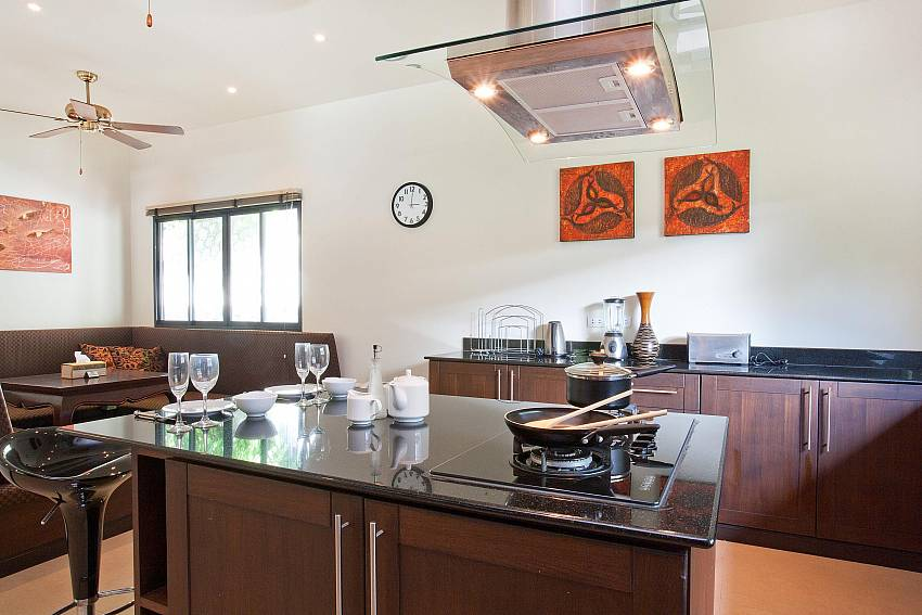 Kitchen with modern appliances at Waew Opal Phuket