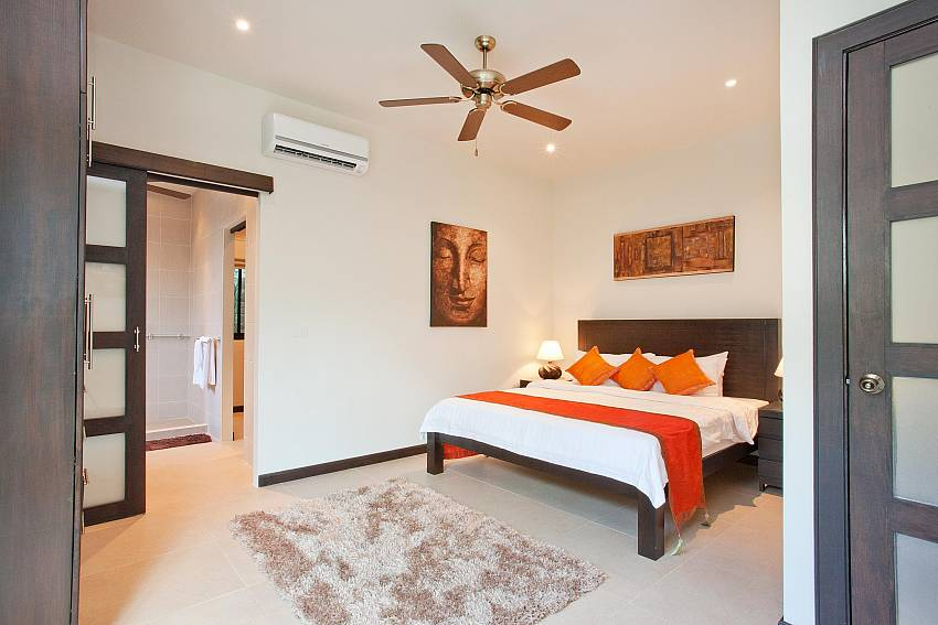 Downstairs Master Bedroom-waew-opal_6-bedroom_private-pool-villa_nai-harn_phuket_thailand