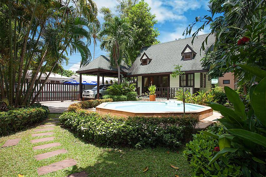 Garden view with Jacuzzi from main house at Villa Damini in Koh Samui