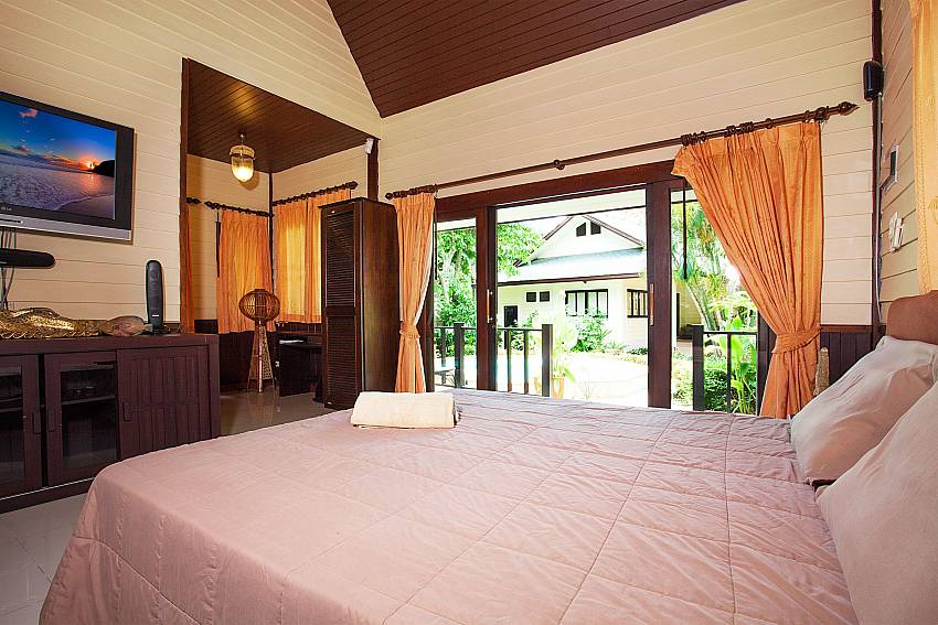 1.bedroom with TV and garden view in main house Villa Damini Samui Thailand