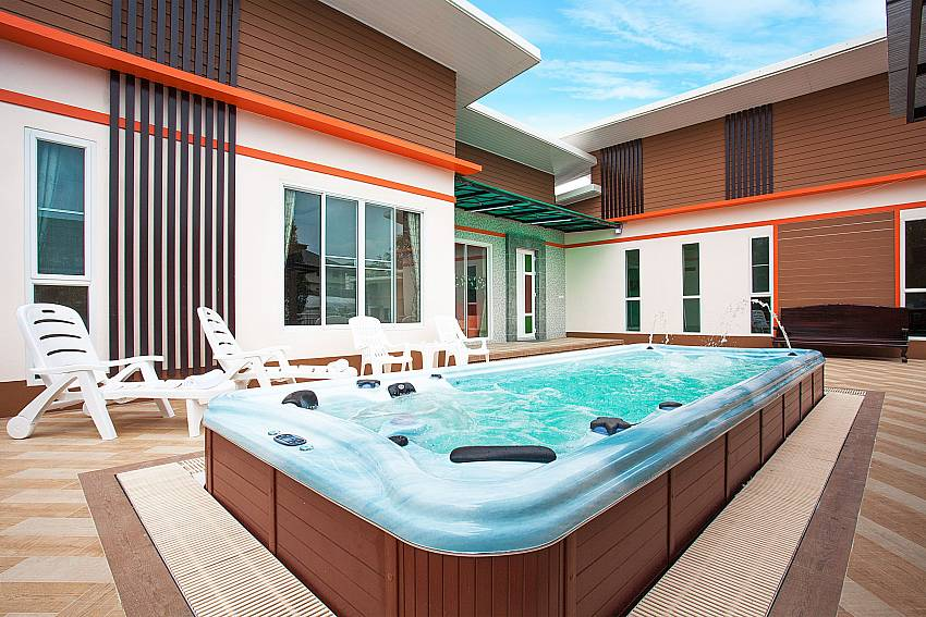 Sun bed near jacuzzi Melodious Villa in East Pattaya